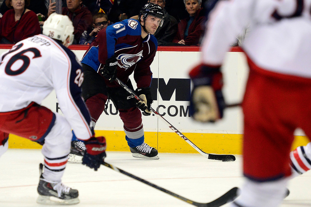 . Andre Benoit (61) of the Colorado Avalanche controls the puck against the Columbus Blue Jackets during the first period. The Colorado Avalanche hosted the Columbus Blue Jackets at the Pepsi Center on Tuesday, December 31, 2013. (Photo by AAron Ontiveroz/The Denver Post)