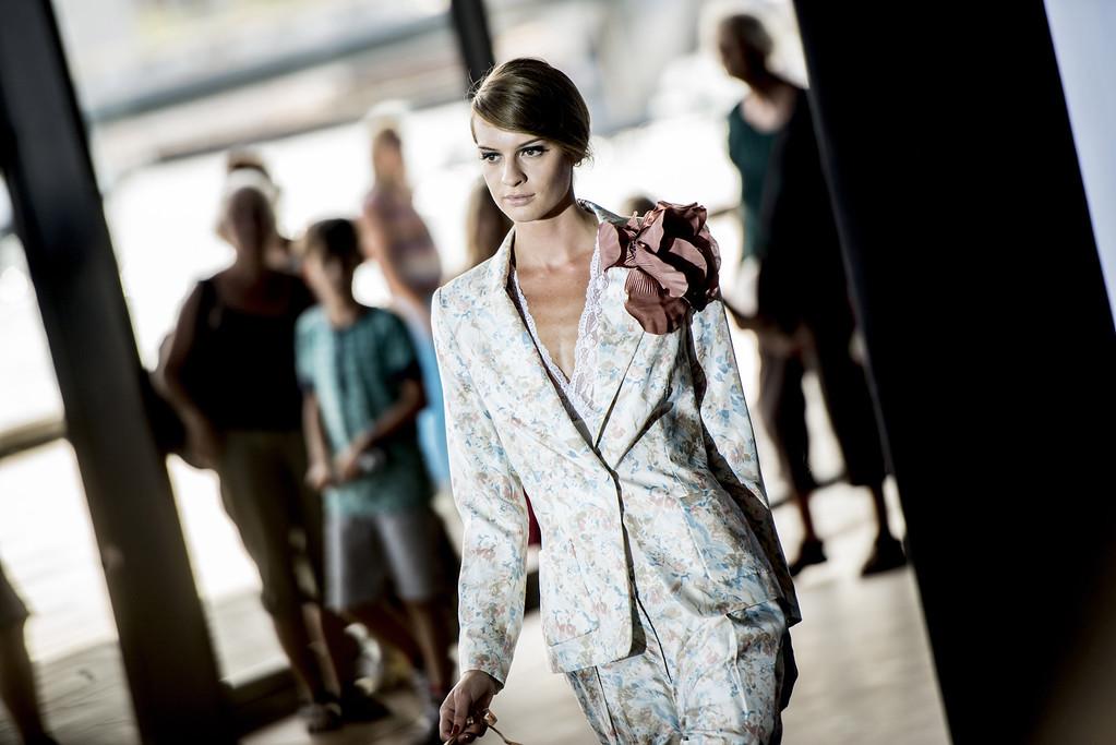 . A model shows off the designs during the Marlene Birger show during Copenhagen Fashion Week Spring/Summer 2014 in Copenhagen, Wednesday, Aug. 7, 2013. (AP Photo/Anthon Unger, POLFOTO)