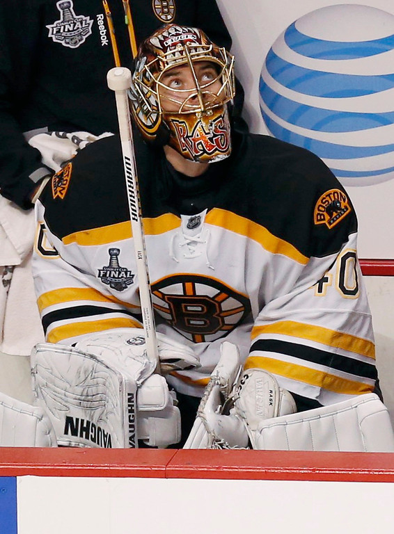 . Boston Bruins goalie Tuukka Rask sits on the bench during the third period after being pulled for an extra attacker against the Chicago Blackhawks in Game 5 of their NHL Stanley Cup Finals hockey series in Chicago, Illinois, June 22, 2013. REUTERS/Jim Young