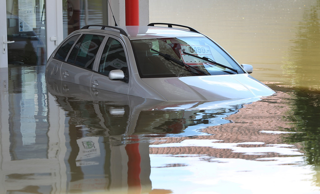 . A car to be sold is overflooded in Deggendorf, southern Germany, on June 5, 2013. AFP PHOTO / KARL-JOSEF HILDENBRAND  /AFP/Getty Images
