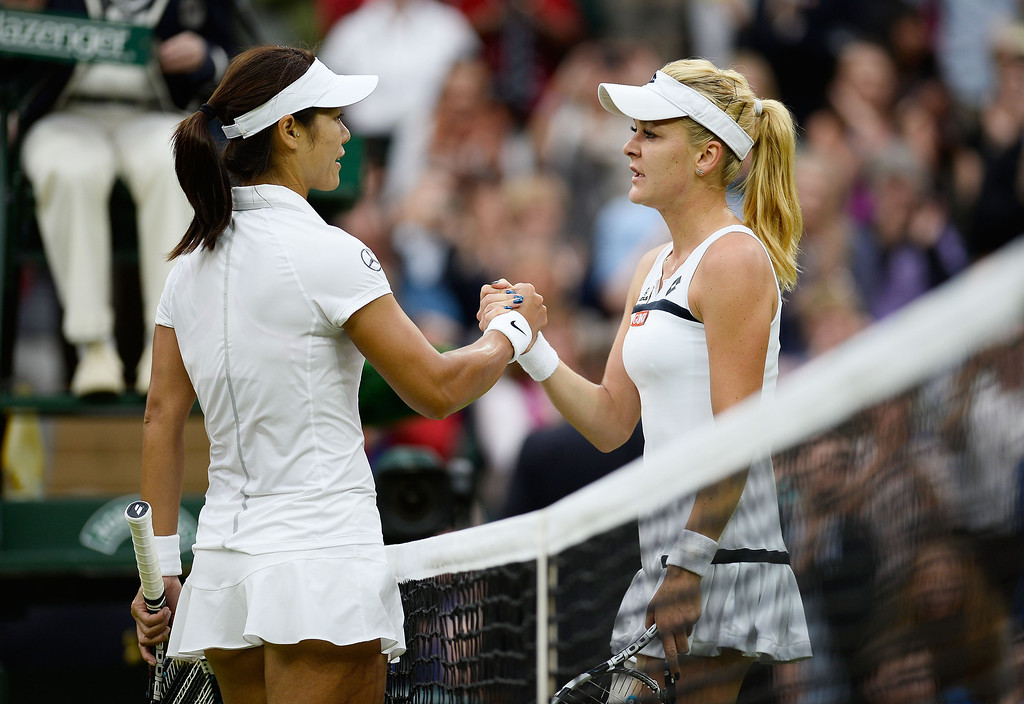 . LONDON, ENGLAND - JULY 02:  Agnieszka Radwanska of Poland shakes hands at the net with Na Li of China after their Ladies\' Singles quarter-final match on day eight of the Wimbledon Lawn Tennis Championships at the All England Lawn Tennis and Croquet Club at Wimbledon on July 2, 2013 in London, England.  (Photo by Dennis Grombkowski/Getty Images)