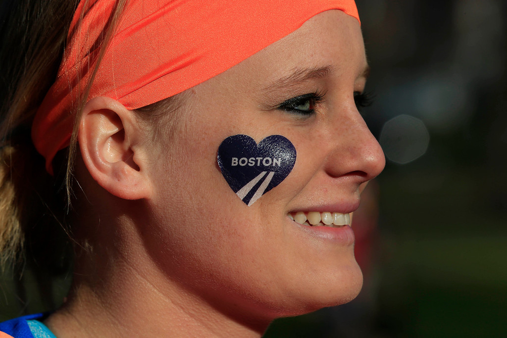 . Mackenzie Petermeier, of Baxter, Iowa, who will be a guide for a blind runner, waits to board a bus in Boston to the starting line in Hopkinton, Mass., for the 118th Boston Marathon Monday, April 21, 2014. (AP Photo/Matt Rourke)