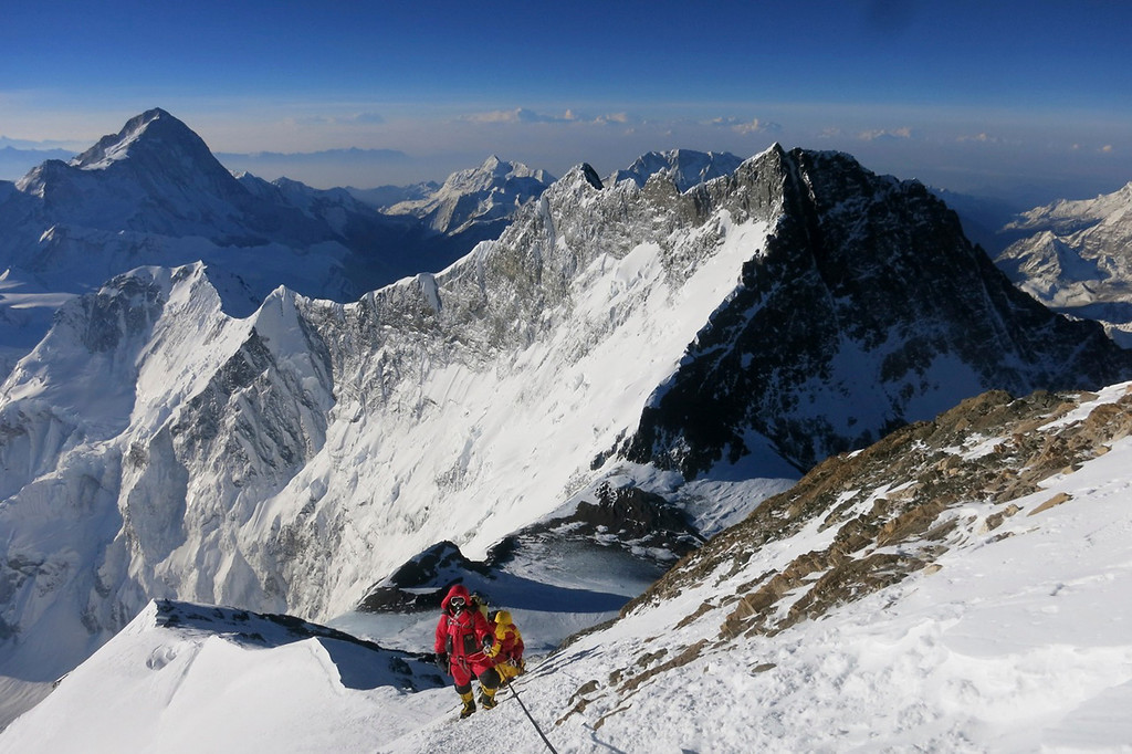 . In this photo from May 18, 2013, Climbers make their way to the summit of Mount Everest, in the Khumbu region of the Nepal Himalayas. Nepal celebrated the 60th anniversary of the conquest of Mount Everest on Wednesday, May 29, 2013, by honoring climbers who followed in the footsteps of Edmund Hillary and Tenzing Norgay. (AP Photo/Alpenglow Expeditions, Adrian Ballinger)