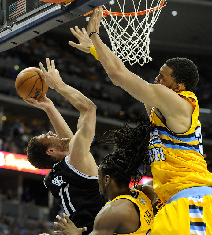 . DENVER, CO. - MARCH 29: Brook Lopez (11) of the Brooklyn Nets tried to get a shot past Kenneth Faried (35) and JaVale McGee (34) of the Denver Nuggets in the second half. The Denver Nuggets defeated the Brooklyn Nets 109-87 Friday night, March 29, 2013 at the Pepsi Center in Denver.  (Photo By Karl Gehring/The Denver Post)