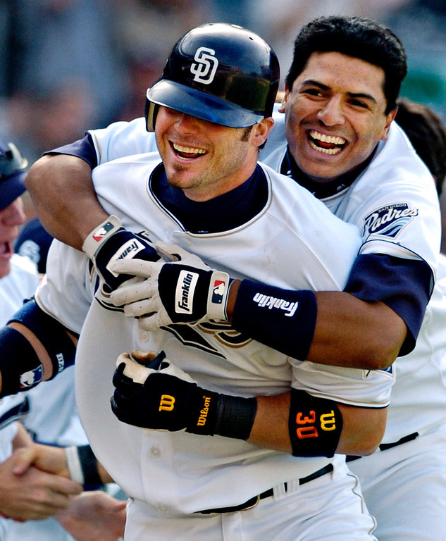 . RYAN KLESKO -- San Diego Padres\' Ryan Klesko, left, is hugged by the Padres\' Miguel Ojeda after Klesko hit a three-run home run off of Arizona Diamondbacks pitcher Matt Mantei in the ninth inning on April 18, 2004, in San Diego. The home run gave the Padres a 6-5 win. (AP Photo/Denis Poroy)