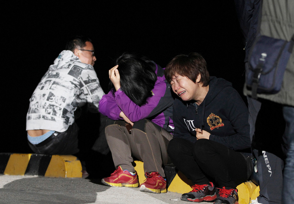 . A relative weeps as she waits for missing passengers of a sunken ferry at Jindo port, South Korea, Wednesday, April 16, 2014. The ferry carrying 459 people, mostly high school students on an overnight trip to a tourist island, sank off South Korea\'s southern coast on Wednesday, leaving nearly 300 people missing despite a frantic, hours-long rescue by dozens of ships and helicopters. (AP Photo/Ahn Young-joon)