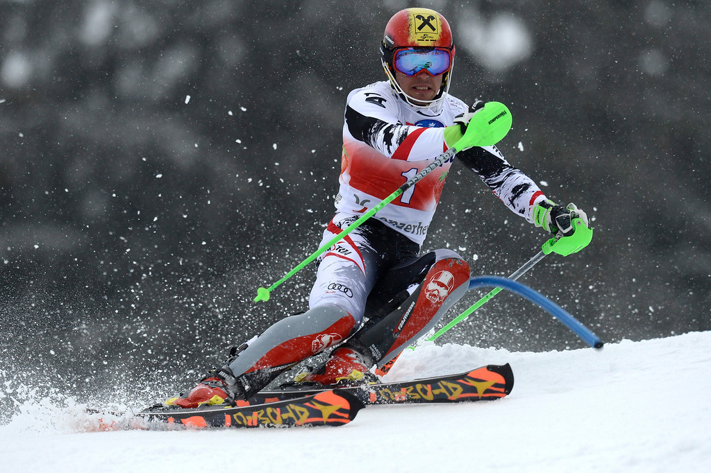 . Marcel Hirscher of Austria speeds down the course in the first run during the men\'s Slalom race at the FIS Alpine Ski World Cup finals, in Parpan-Lenzerheide, Switzerland, 16 March 2014.  EPA/PETER SCHNEIDER