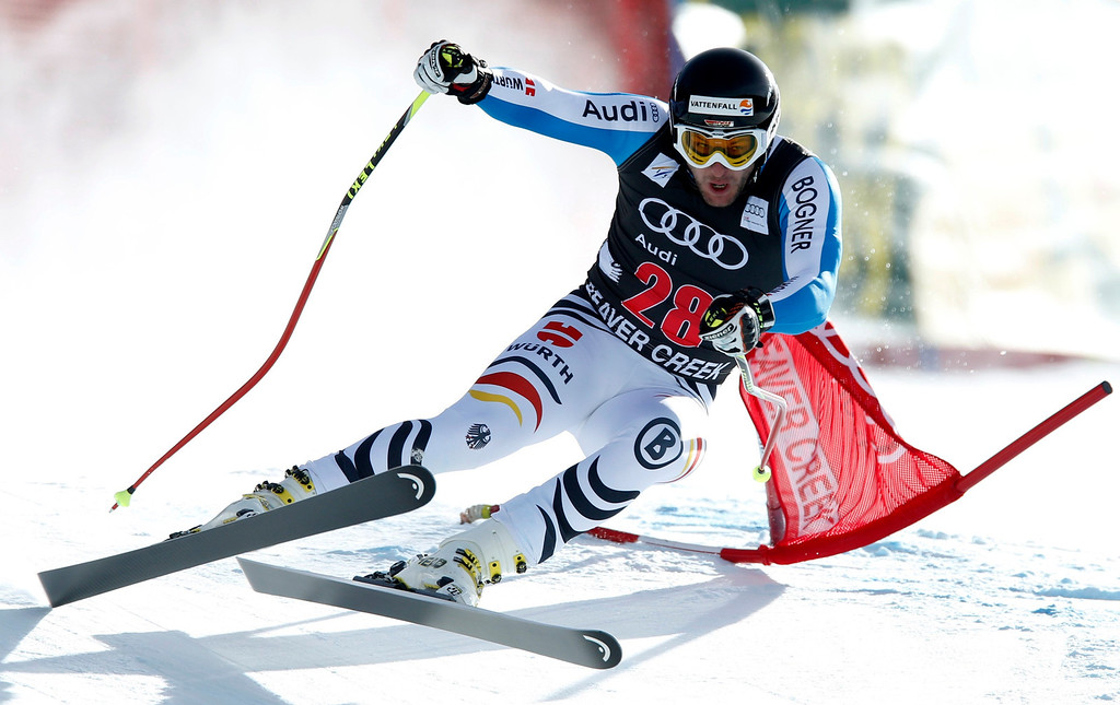. Stephan Keppler of Germany crashes through a gate in the men\'s World Cup downhill ski race in Beaver Creek, Colorado, November 30, 2012.    REUTERS/Mike Segar
