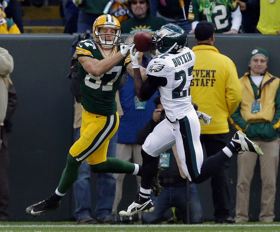 . Philadelphia Eagles\' Brandon Boykin intercepts a pass in front of Green Bay Packers\' Jordy Nelson (87) during the first half of an NFL football game Sunday, Nov. 10, 2013, in Green Bay, Wis. (AP Photo/Mike Roemer)
