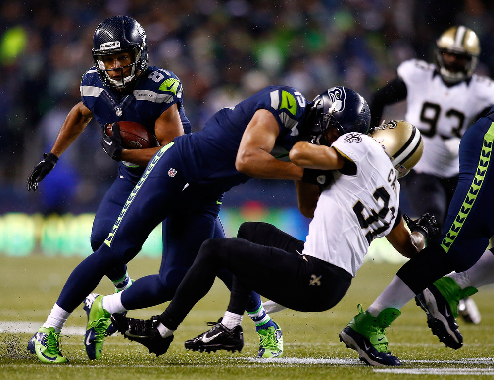 . Wide receiver Golden Tate #81 of the Seattle Seahawks runs after a reception against the New Orleans Saints during a game at CenturyLink Field on December 2, 2013 in Seattle, Washington.  (Photo by Jonathan Ferrey/Getty Images)