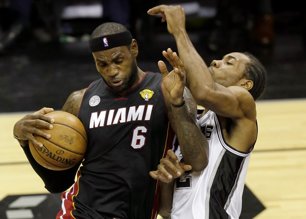 . Miami Heat\'s LeBron James (6) is defended by San Antonio Spurs\' Kawhi Leonard during the first half at Game 4 of the NBA Finals basketball series, Thursday, June 13, 2013, in San Antonio. (AP Photo/David J. Phillip)