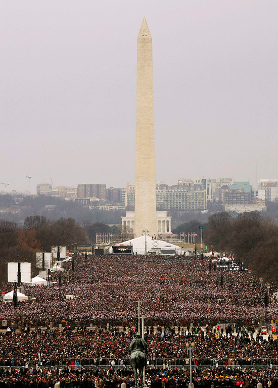. The Washington Monument is pictured, with crowds on the Mall before the start of swearing-in ceremonies for U.S. President Barack Obama on the West front of the U.S Capitol in Washington, January 21, 2013. REUTERS/Rick Wilking