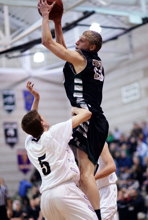 . Alex Semadeni of Fossil Ridge High School (23), top, controls offensive rebound against Sam Fredricksmeyer of Monarch High School (5) in the 1st half of the game at Monarch High School Gym.   (Photo by Hyoung Chang/The Denver Post)
