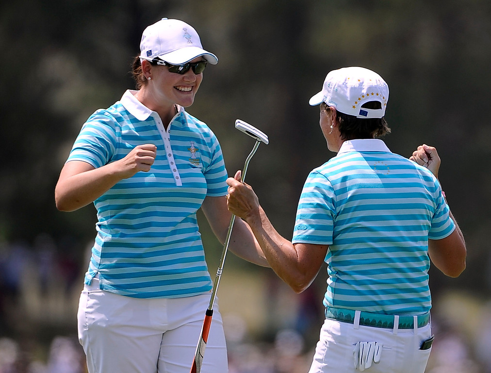 . PARKER, CO - Aug.17: Team Europe\'s Caroline Masson, left, and Catriona Matthew celebrate on the 18th. The 2013 Solheim Cup takes place at the Colorado Golf Club with the USA taking on Europe in the Saturday morning Foursomes Match. (Photo By Kathryn Scott Osler/The Denver Post)