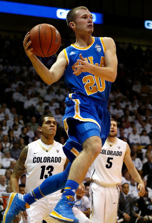 . UCLA\'s Bryce Alford drives during the first half of an NCAA college basketball game against Colorado in Boulder, Colo., Thursday, Jan. 16, 2014. (AP Photo/Brennan Linsley)
