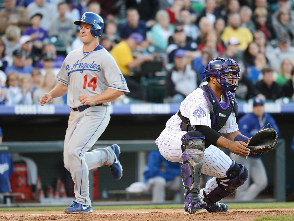 . DENVER, CO. - MAY 31: Mark Ellis of Los Angeles Dodgers (14) scores in the 3rd inning of the game by catcher Wilin Rosario of Colorado Rockies (20) at Coors Field. Denver, Colorado. May 31, 2013. (Photo By Hyoung Chang/The Denver Post)