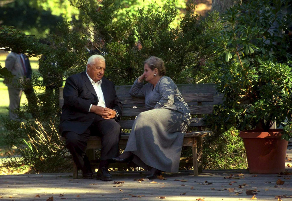 . A file handout photo made available by the Israeli Government Press Office dated 18 October 1998 shows Ariel Sharon, then Israeli foreign minister as he sits on a bench and chats with US former Secretary of State Madeleine Albright (R) during the Wye Plantation summit in Wye, Virginia, USA.  EPA/AVI OHAYON  /  GPO