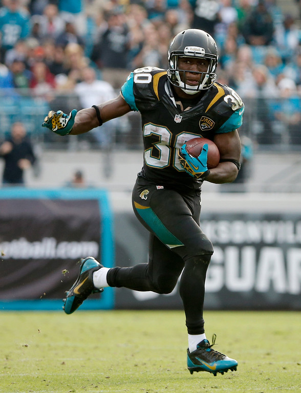 . Jordan Todman #30 of the Jacksonville Jaguars runs for yardage during the game against the Buffalo Bills at EverBank Field on December 15, 2013 in Jacksonville, Florida.  (Photo by Sam Greenwood/Getty Images)