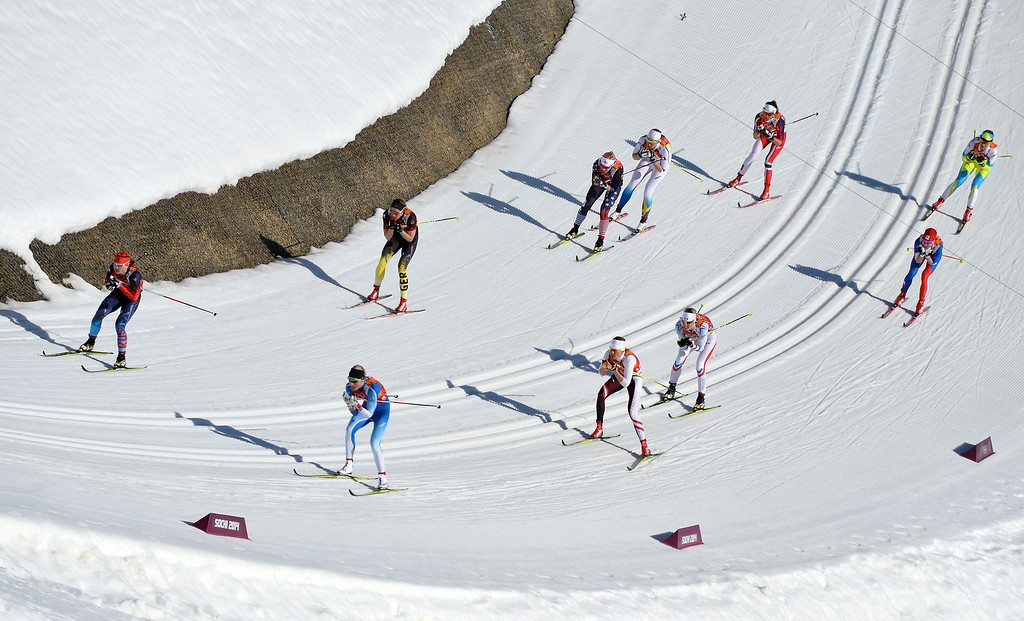. Athletes compete in the Women\'s Cross-Country Skiing 4x5km Relay at the Laura Cross-Country Ski and Biathlon Center during the Sochi Winter Olympics on February 15, 2014, in Rosa Khutor, near Sochi.    ALBERTO PIZZOLI/AFP/Getty Images