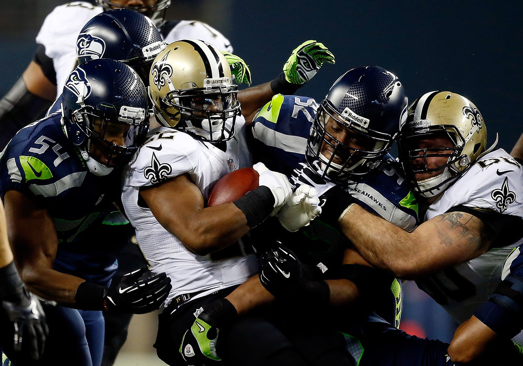 . Running back Mark Ingram #22 of the New Orleans Saints carries the ball against the Seattle Seahawks during a game at CenturyLink Field on December 2, 2013 in Seattle, Washington.  (Photo by Otto Greule Jr/Getty Images)