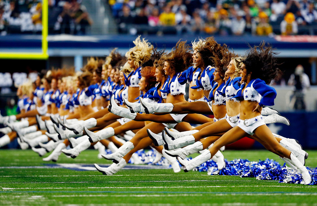 . Dallas Cowboys cheerleaders perform prior to a game against the Green Bay Packers at AT&T Stadium on December 15, 2013 in Arlington, Texas.  (Photo by Tom Pennington/Getty Images)