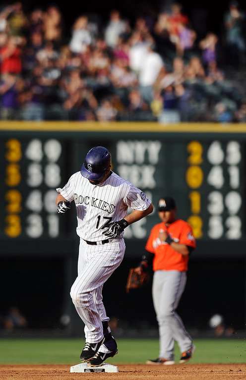. Colorado Rockies\' Todd Helton rounds the bases after hitting a home run in the second inning of a baseball game against the Miami Marlins on Tuesday, July 23, 2013 in Denver. (AP Photo/Chris Schneider)