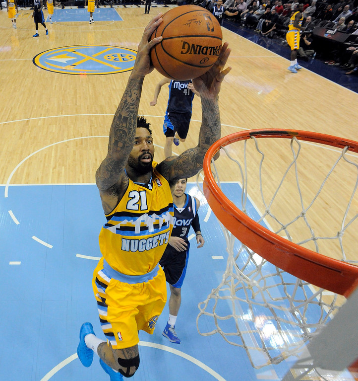 . Denver Nuggets small forward Wilson Chandler (21) gets an easy break away dunk past Dallas Mavericks point guard Shane Larkin (3) March 5, 2014 at Pepsi Center. The Denver Nuggets defeated the Dallas Mavericks 115-110. (Photo by John Leyba/The Denver Post)