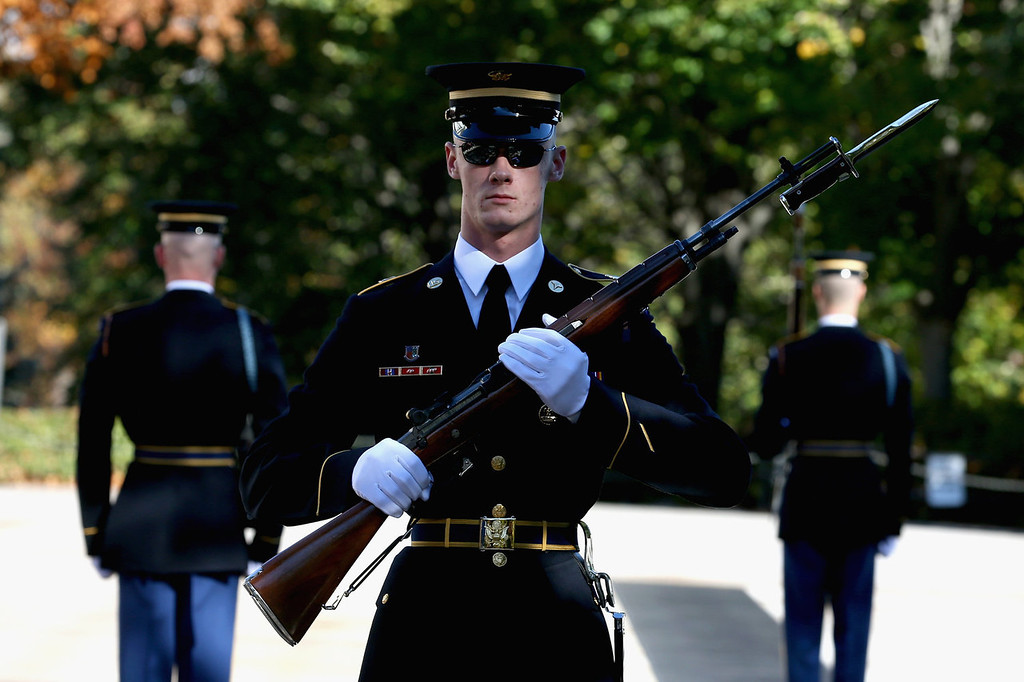 . Members of the military color guard stands at attention before a ceremony where U.S. President Barack Obama will lay a commemorative wreath for Veterans Day at the Tomb of the Unknowns at Arlington National Cemetery on November 11, 2013 in Arlington, Virginia. For Veterans Day, President Obama is paying tribute to military veterans past and present who have served and sacrificed their lives for their country.  (Photo by Mark Wilson/Getty Images)