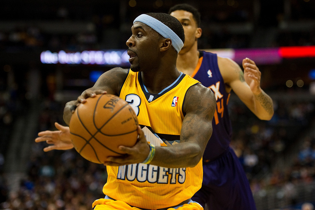 . DENVER, CO - DECEMBER 20: Ty Lawson #3 of the Denver Nuggets looks to pass against Gerald Green #14 of the Phoenix Suns during the first quarter of an NBA game at the Pepsi Center on December 20, 2013, in Denver, Colorado. (Photo by Daniel Petty/The Denver Post)