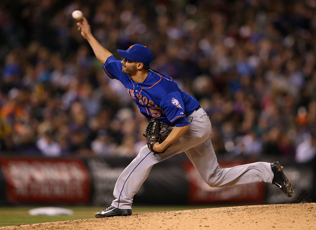 . DENVER, CO - MAY 02:  Relief pitcher Carlos Torres #52 of the New York Mets delivers against the Colorado Rockies at Coors Field on May 2, 2014 in Denver, Colorado.  (Photo by Doug Pensinger/Getty Images)