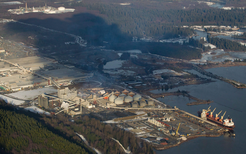 . A cargo ship sits docked at Rio Tinto Alcan\'s Kitimat Smelter on Douglas Channel, the proposed termination point for an oil pipeline in the Enbridge Northern Gateway Project, in Kitimat, B.C., on Jan.10, 2012.  (AP Photo/The Canadian Press, Darryl Dyck)