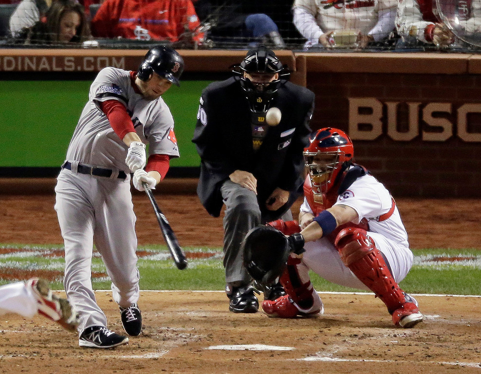 . Boston Red Sox\'s Stephen Drew hits a sacrifice fly during the fifth inning of Game 4 of baseball\'s World Series against the St. Louis Cardinals Sunday, Oct. 27, 2013, in St. Louis. David Ortiz scored from third on the sacrifice fly.  (AP Photo/Charlie Riedel)