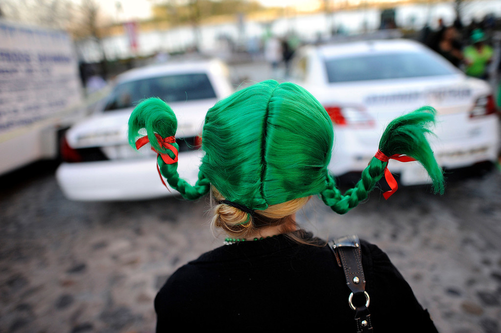 . Dressed as Pippie Longstocking, Tiffany Martinez, of Tampa, Fla., walks along historic River Street during the 189-year-old St. Patrick\'s Day celebration on River Street, Friday, Mar. 15, 2013, in Savannah, Ga. (AP Photo/Stephen Morton)
