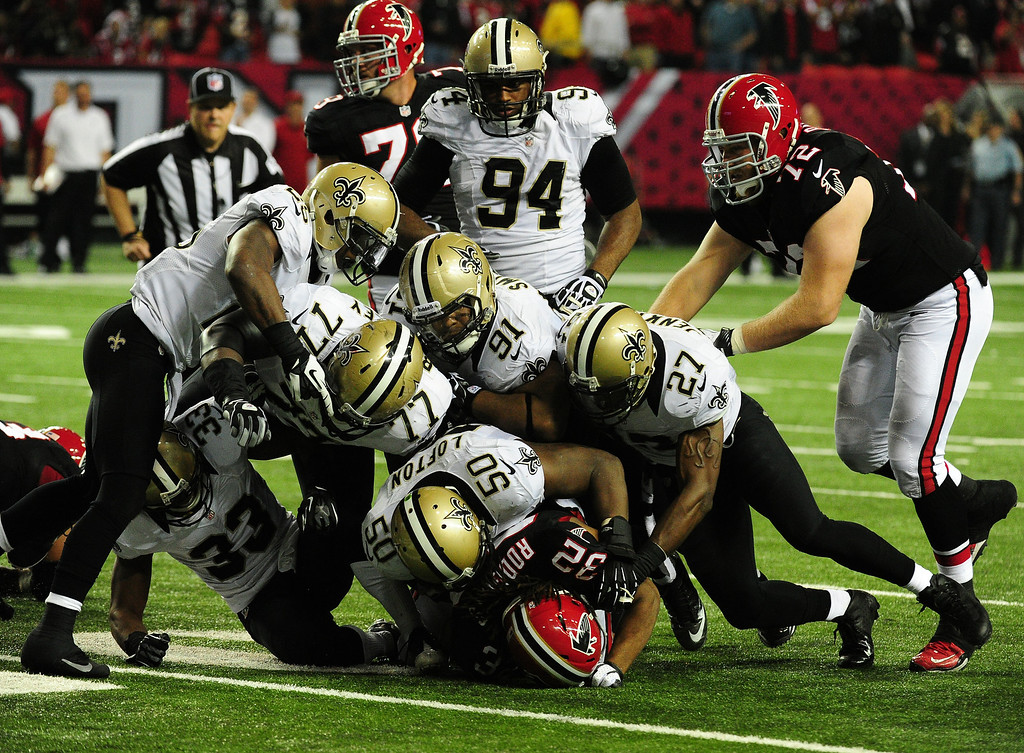 . ATLANTA, GA - NOVEMBER 18:  Jacquizz Rodgers #32 of the Atlanta Falcons is tackled by Curtis Lofton #50 of the New Orleans Saints at the Georgia Dome on November 29, 2012 in Atlanta, Georgia  (Photo by Scott Cunningham/Getty Images)