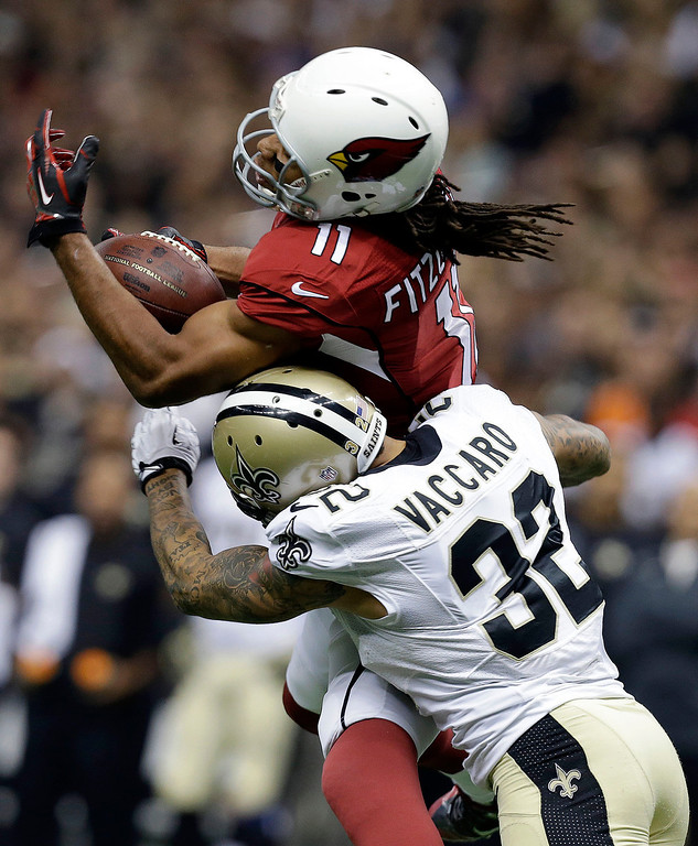 . Arizona Cardinals wide receiver Larry Fitzgerald (11) pulls in a pass over New Orleans Saints strong safety Kenny Vaccaro (32) in the first half of an NFL football game in New Orleans, Sunday, Sept. 22, 2013. (AP Photo/Gerald Herbert)