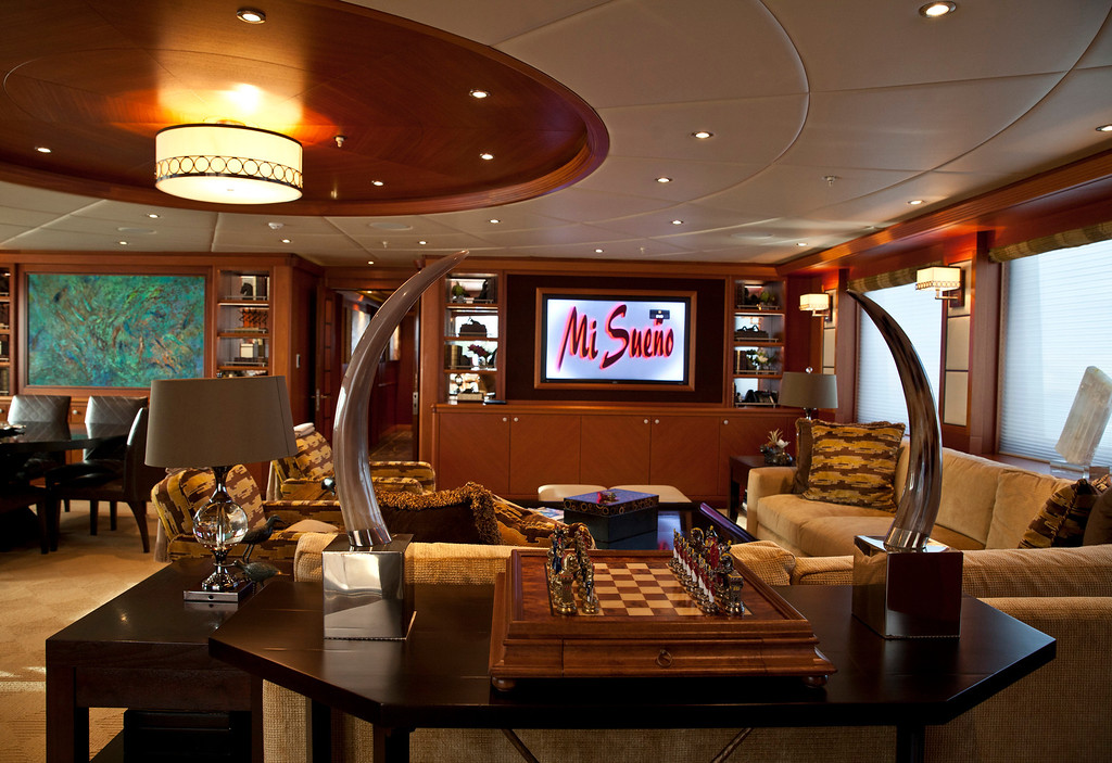 . A chess board sits on a table as a 42 inch flat-screen television sits on a wall inside the 190ft (57.9m) motor yacht Mi Sueno, manufactured by Trinity Yachts LLC, as it sits moored in the harbor in Nice, France, on Wednesday, Sept. 25, 2013.  Photographer: Balint Porneczi/Bloomberg