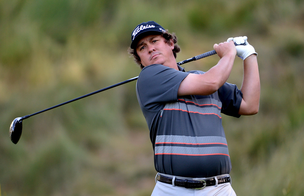 . Jason Dufner of the United States hits his tee shot on the 18th hole during the continuation of Round Two of the 113th U.S. Open at Merion Golf Club on June 15, 2013 in Ardmore, Pennsylvania.  (Photo by Ross Kinnaird/Getty Images)