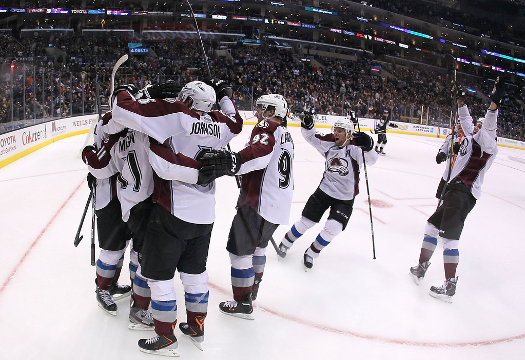 . LOS ANGELES, CA - NOVEMBER 23:  Jamie McGinn #11 of the Colorado Avalanche celebrates his overtime goal with teammates against the Los Angeles Kings in  the NHL game at Staples Center on November 23, 2013 in Los Angeles, California. The Avalanche defeated the Kings 1-0. (Photo by Victor Decolongon/Getty Images)
