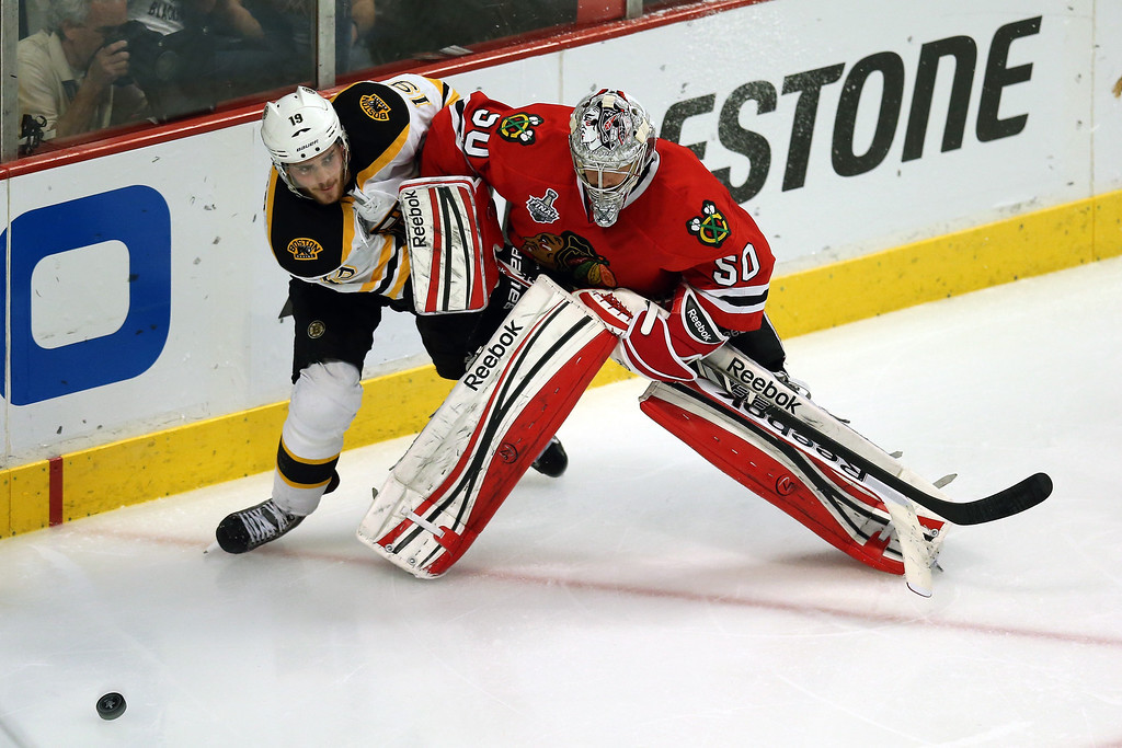 . CHICAGO, IL - JUNE 15:  Tyler Seguin #19 of the Boston Bruins and goalie Corey Crawford #50 of the Chicago Blackhawks get their sticks tied up in Game Two of the NHL 2013 Stanley Cup Final at United Center on June 15, 2013 in Chicago, Illinois.  (Photo by Jonathan Daniel/Getty Images)