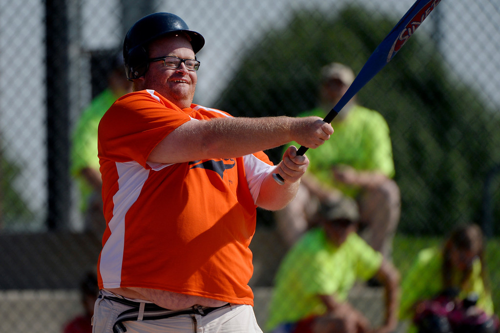 . DENVER, CO. - AUGUST 17:  Adam Aldridge of the Colorado Springs Padres, makes hit against the Parker Power during the Special Olympics softball state championship at the Lowry Sports Complex in Denver, CO August 17, 2013. Special Olympics Colorado hosted its state championship in Bocce, Cycling, Golf, Softball and Tennis. Six hundred athletes competed in the events, which was supported by 250 volunteers and coaches. (Photo By Craig F. Walker / The Denver Post)