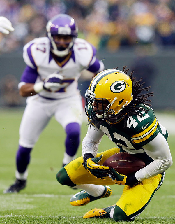. Green Bay Packers free safety Morgan Burnett (42) intercepts a pass during the second half of an NFL football game against the Minnesota Vikings Sunday, Dec. 2, 2012, in Green Bay, Wis. The Packers won 23-14. (AP Photo/Morry Gash)