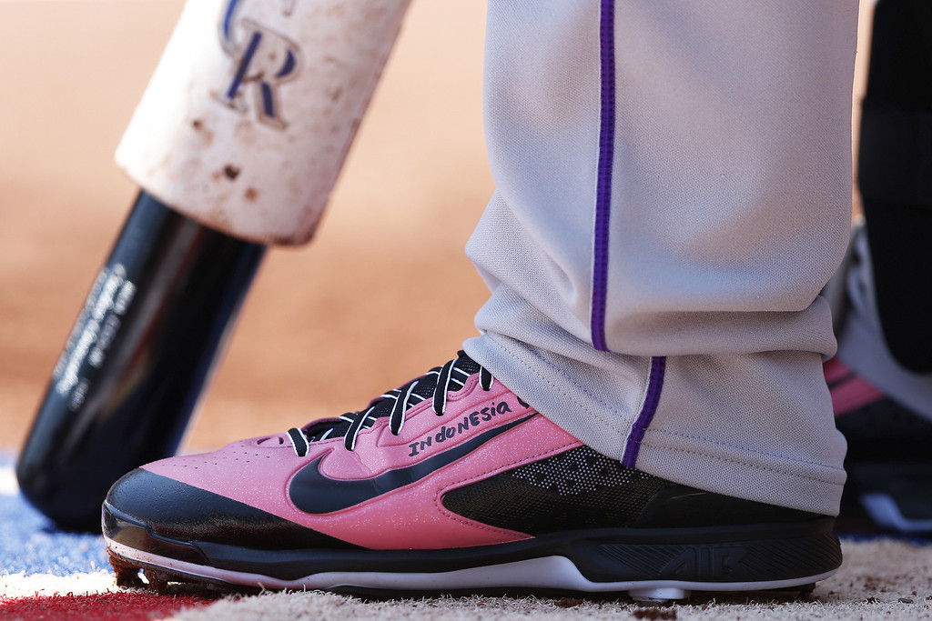 . Carlos Gonzalez #5 of the Colorado Rockies is seen wearing special pink Nike shoes as he waits to bat in the first inning of the game against the Cincinnati Reds at Great American Ball Park on May 11, 2014 in Cincinnati, Ohio. (Photo by Joe Robbins/Getty Images)