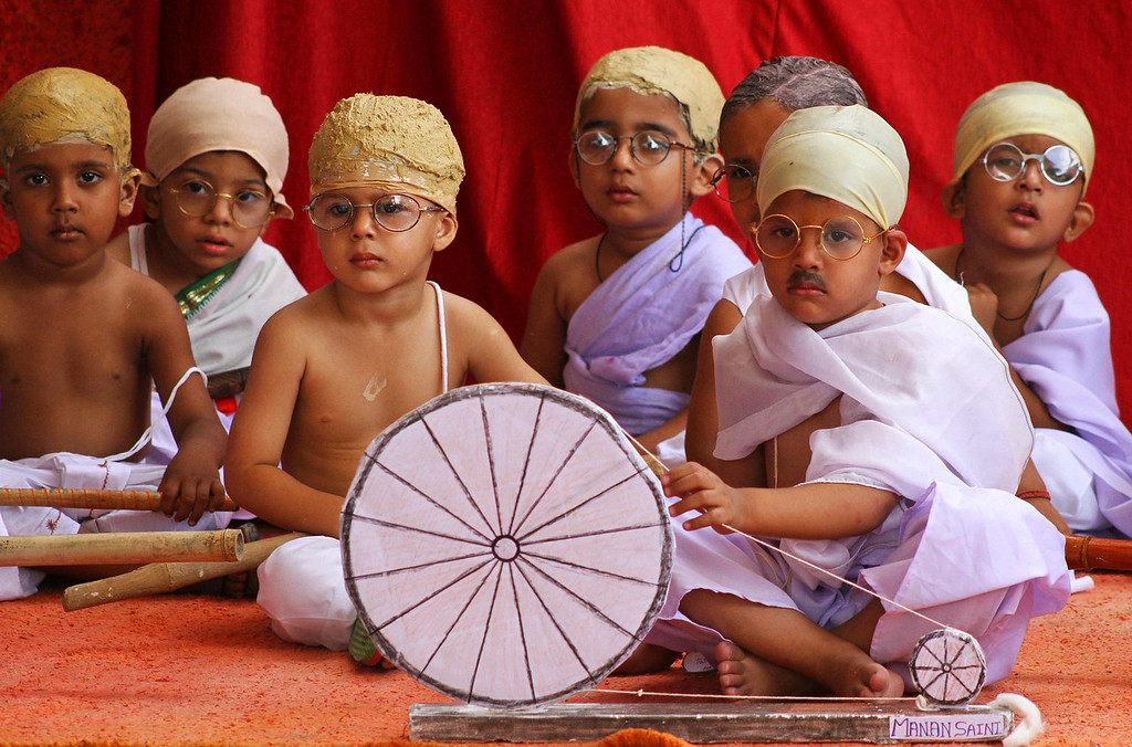 . Indian children dressed like Mahatma Gandhi assemble at an event during Gandhi Jayanti in Ajmer, India, Wednesday, Oct. 2, 2013. Gandhi Jayanti is the birth anniversary of Gandhi, the father of the nation. (AP Photo/Deepak Sharma)