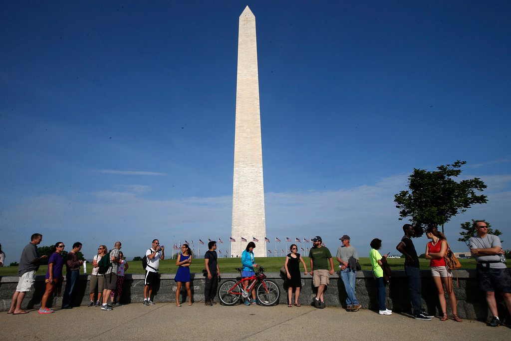 . Visitors line up for tickets which are distributed at on a first-come basis at the Washington Monument in Washington, Monday, May 12, 2014, ahead of a ceremony to celebrate its re-opening. The monument, which sustained damage from an earthquake in August 2011, is reopening to the public today. (AP Photo)
