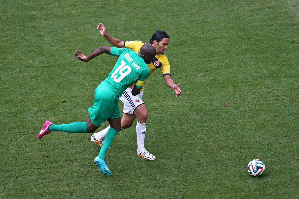 . Yaya Toure of the Ivory Coast and Abel Aguilar of Colombia compete for the ball during the 2014 FIFA World Cup Brazil Group C match between Colombia and Cote D\'Ivoire at Estadio Nacional on June 19, 2014 in Brasilia, Brazil.  (Photo by Adam Pretty/Getty Images)