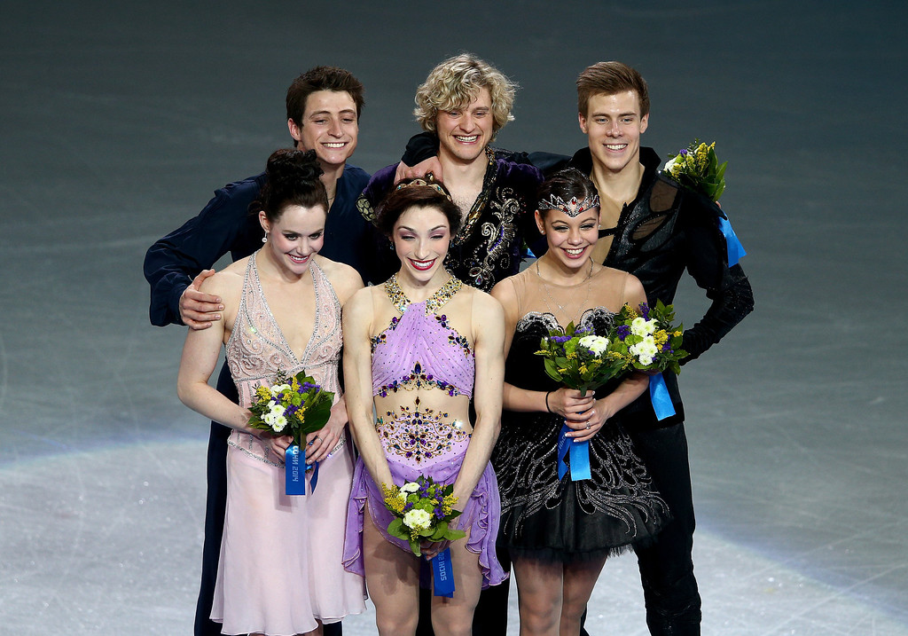 . (L-R) Silver medalists Tessa Virtue and Scott Moir of Canada, gold medalists Meryl Davis and Charlie White of the United States, and bronze medalists Elena Ilinykh and Nikita Katsalapov of Russia celebrate on the podium during the flower ceremony for the Figure Skating Ice Dance on Day 10 of the Sochi 2014 Winter Olympics at Iceberg Skating Palace on February 17, 2014 in Sochi, Russia.  (Photo by Clive Mason/Getty Images)