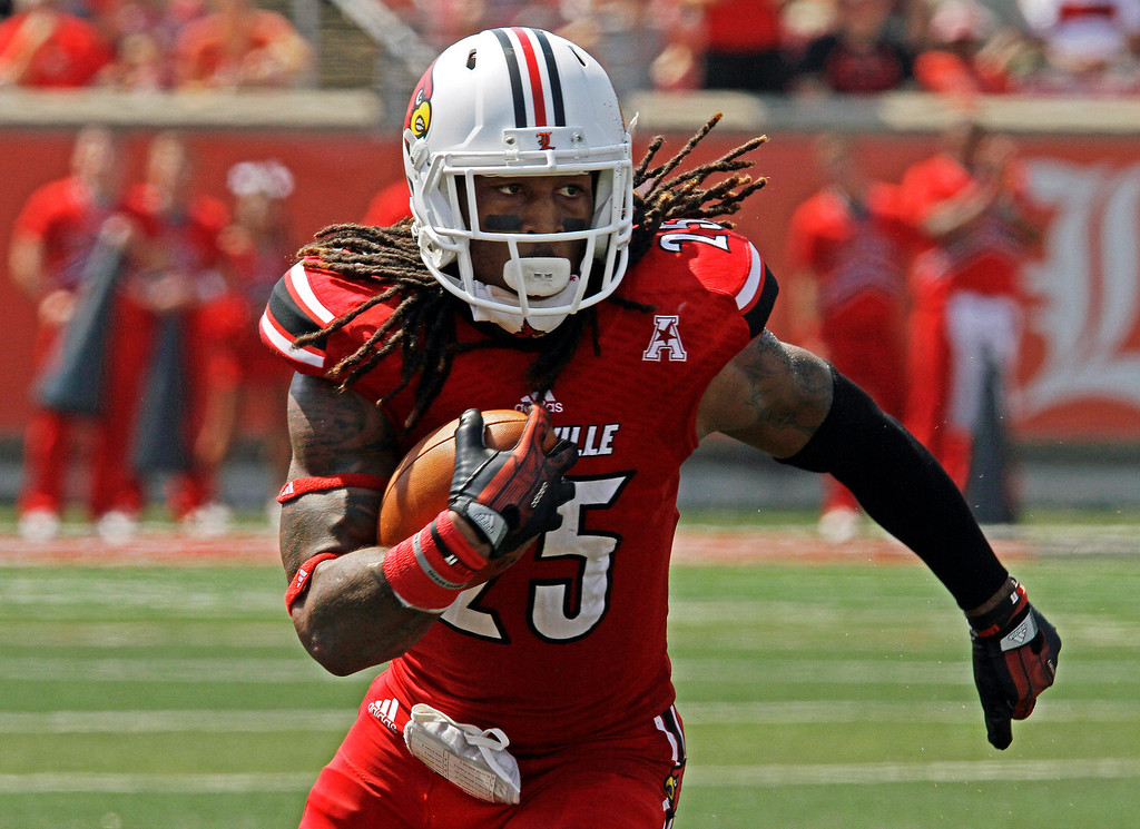 . In this Sept. 7, 2013, file photo, Louisville\'s Calvin Pryor turns and runs after picking off a pass against Eastern Kentucky in an NCAA college football game in Louisville, Ky. Pryor was selected in the first round, 18th overall, by the New York Jets in the NFL draft on Thursday, May 8, 2014.  (AP Photo/Garry Jones, File)