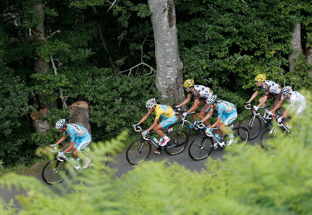 . The pack with Italy\'s Vincenzo Nibali, wearing the overall leader\'s yellow jersey, climbs Val Louron Azet pass during the seventeenth stage of the Tour de France cycling race over 124.5 kilometers (77.4 miles) with start in Saint-Gaudens and finish in Saint-Lary, France, Wednesday, July 23, 2014. (AP Photo/Christophe Ena)