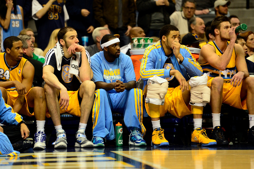 . Denver Nuggets point guard Ty Lawson (3) sits on the bench with teammates during the second half of the Nugget\'s 92-78 win at the Pepsi Center on Tuesday, January 1, 2013. AAron Ontiveroz, The Denver Post