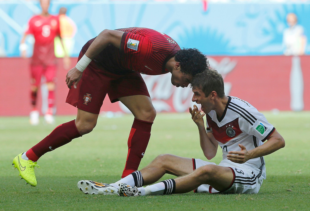 . Portugal\'s Pepe, left, puts his head on Germany\'s Thomas Mueller during the group G World Cup soccer match between Germany and Portugal at the Arena Fonte Nova in Salvador, Brazil, Monday, June 16, 2014.  Pepe was red carded after this.  (AP Photo/Matthias Schrader)